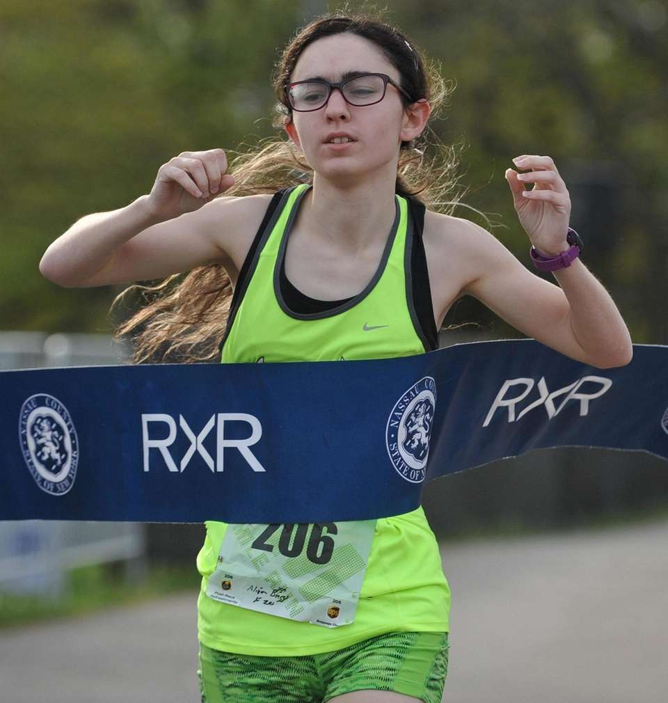 Alison Briggs, 20, of Commack crosses the finish