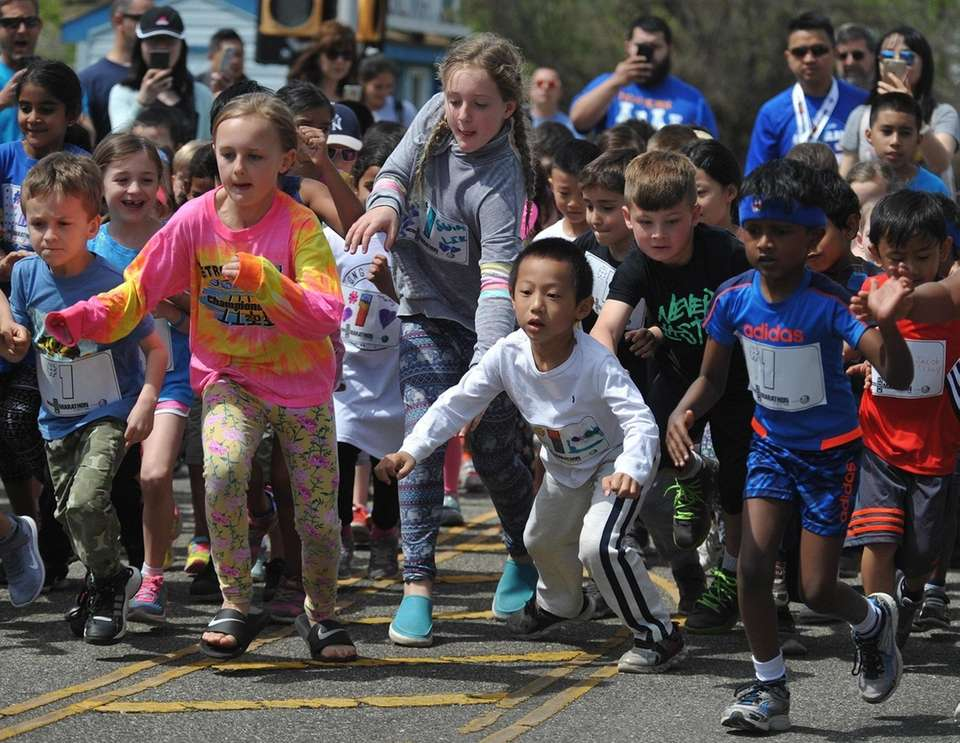Children compete in the the Kids Mini Marathon