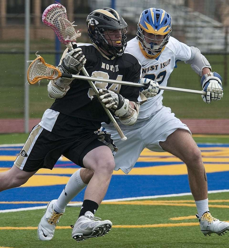 (L) Sachem #34 Timmy Lang rushes for the