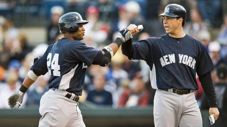 New York Yankees' Mark Teixeira, right, greets Robinson