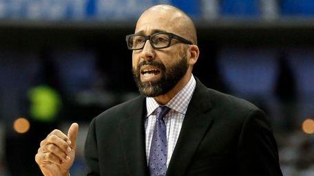 Grizzlies head coach David Fizdale celebrates a basket