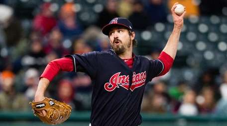 Andrew Miller of the Indians pitches during the