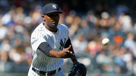 Domingo German of the Yankees flips the ball