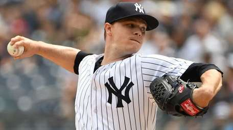 Yankees starting pitcher Sonny Gray delivers against the
