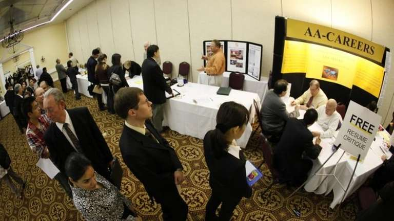 Job seekers line up for a resume critique