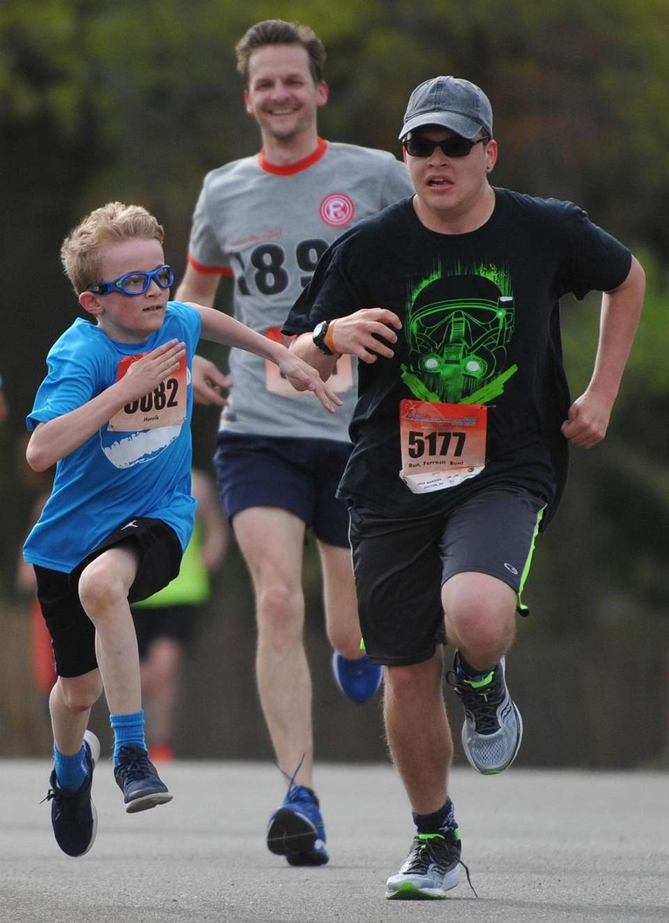 Henrik Kollmeier, 10, of Farmingdale, left, races toward