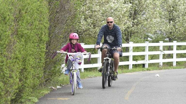 Kevin Graber, of Islip Terrace, rides his bicycle