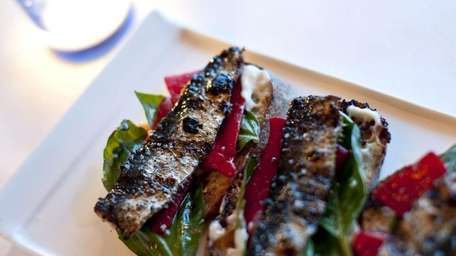Grilled sardines are served at Noah's, a new