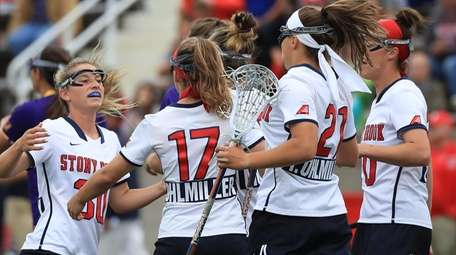 Teammates congratulate Stony Brook's Kylie Ohlmiller after a