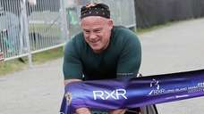 Pete Hawkins of Malverne wins the push wheelchair
