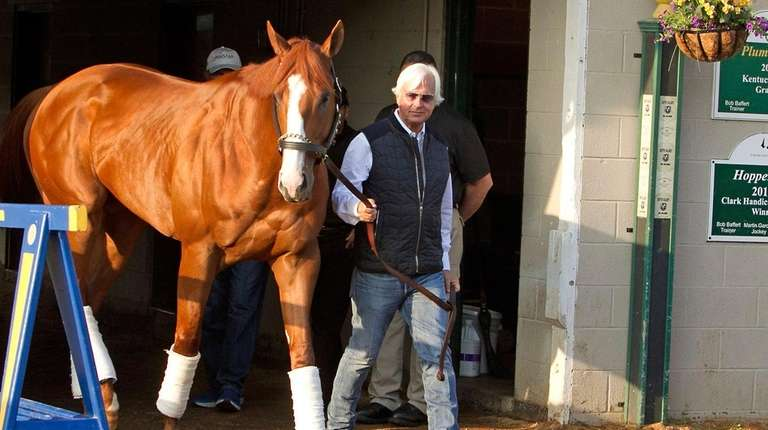 Justify, led by trainer Bob Baffert, emerges from