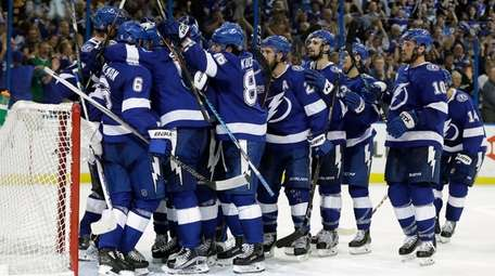 The Lightning celebrate their win over the Boston