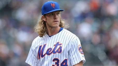Mets starting pitcher Noah Syndergaard walks to the