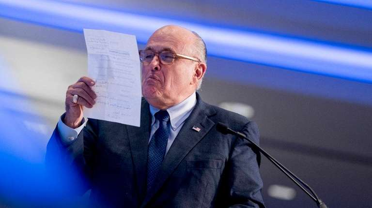 Rudy Giuliani pretends to spit on the Iran