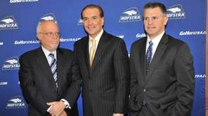 Tim Welsh, center, is flaked by Hofstra President