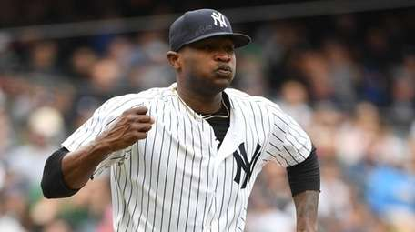 Yankees starting pitcher Domingo German reacts after he