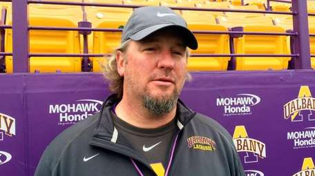 Albany men's lacrosse coach Scott Marr talks to
