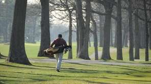 A golfer takes advantage of the beautiful day