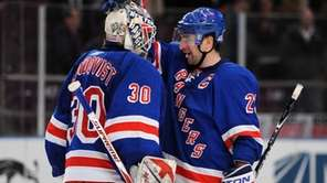 Chris Drury, right, congratulates Henrik Lundqvist after a
