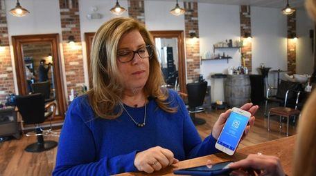Alyse Cardello of Massapequa pays at LG Salon