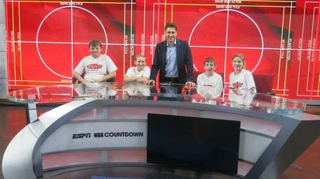 ESPN host Mike Greenberg, center, with Kidsday reporters,