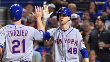 Todd Frazier is congratulated by Jacob deGrom after