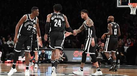 Brooklyn Nets guard D'Angelo Russell, second from right,
