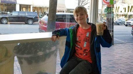 Kidsday reporter David Bernstein enjoying some bubble tea