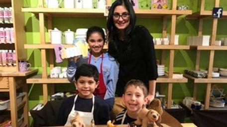 Kidsday reporter Charlotte Nerayoff and ceramics instructor Lillian