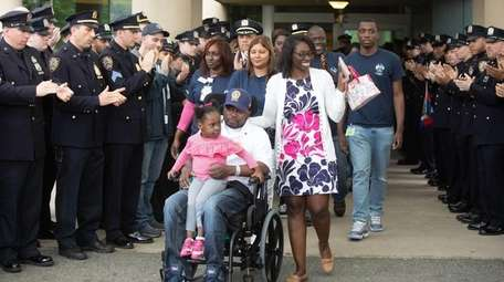 NYPD Detective Dalsh Veve, with his daughter Darshee