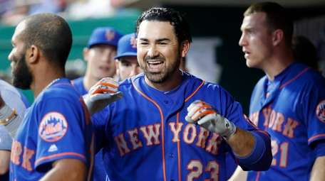 The Mets' Adrian Gonzalez celebrates in the dugout