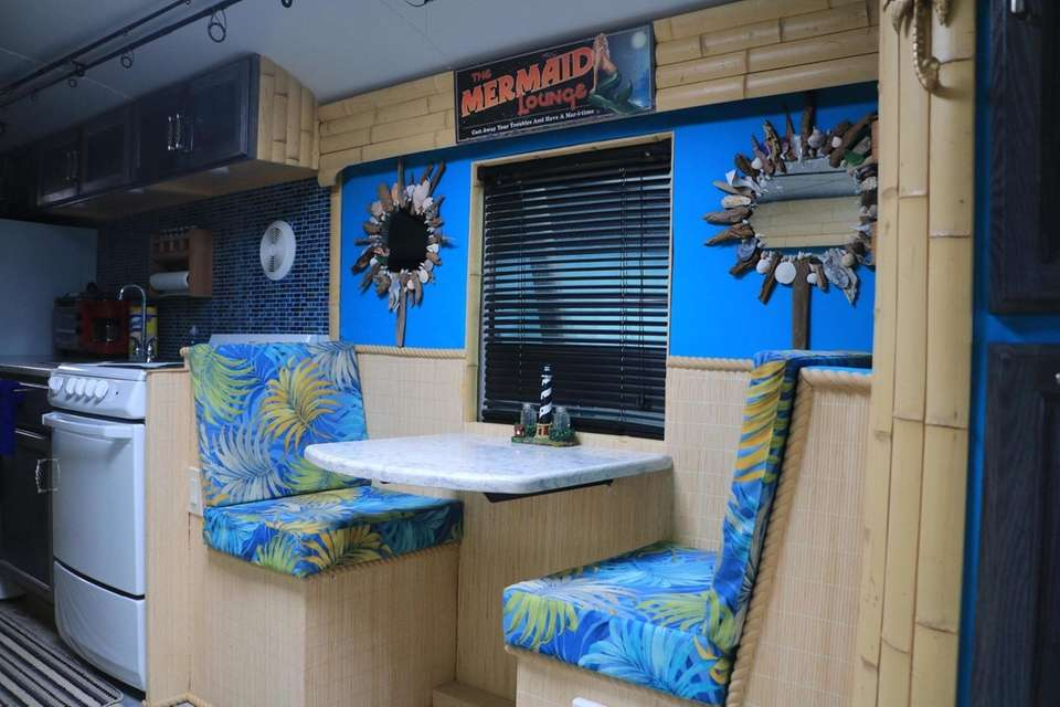 """The dining area on """"Fishing Fanatic"""" features a"""