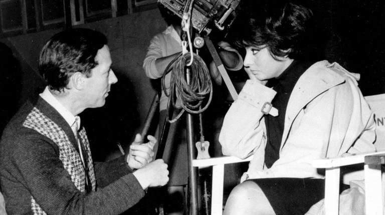 Director Michael Anderson talks with Sophia Loren on