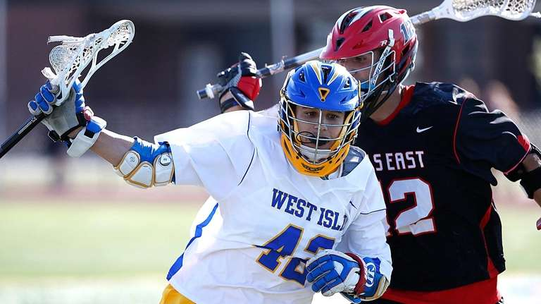 West Islip's Joey Costantino drives against Half Hollow
