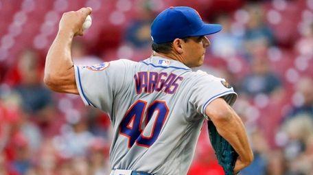 Mets pitcher Jason Vargas delivers during a game