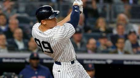 Yankees outfielder Aaron Judge follows through on a