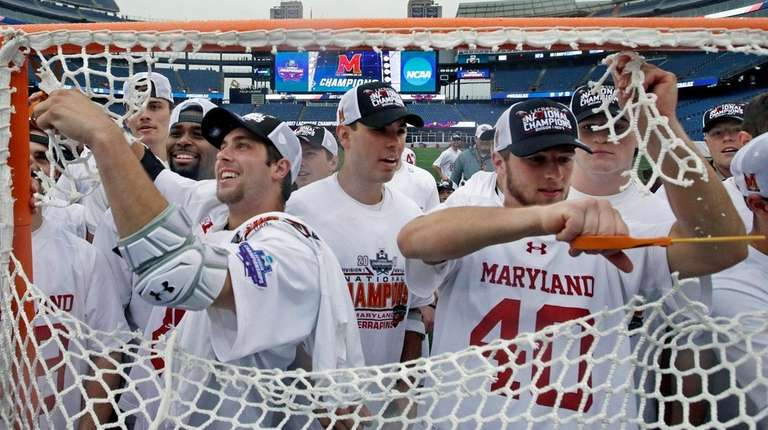 Maryland players cut the net to celebrate after
