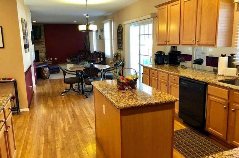 The granite kitchen in this St. James Colonial
