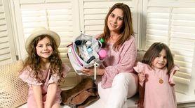 Handbag designer Rebecca Cohn holds a Nappie Sack,