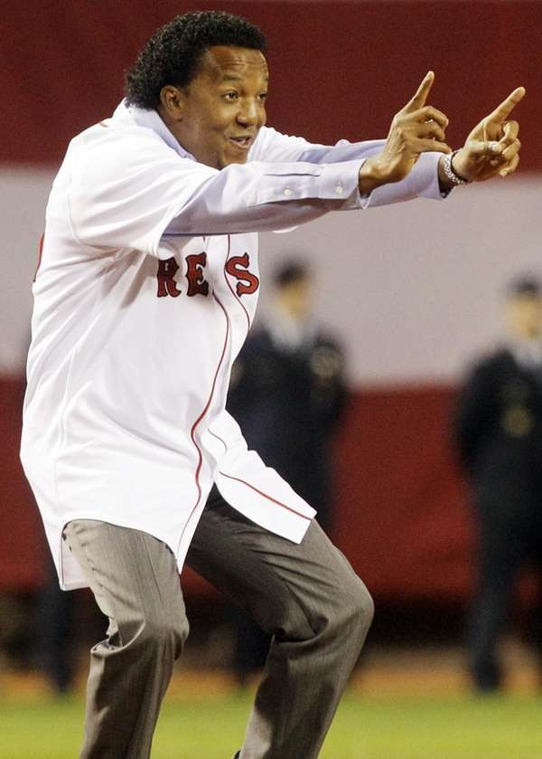 Former Boston Red Sox pitcher Pedro Martinez greets