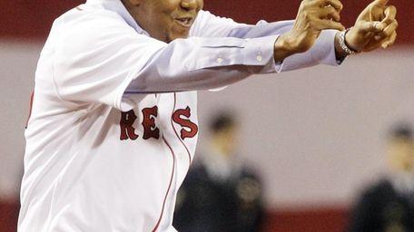 Former Boston Red Sox pitcher Pedro Martinez greets