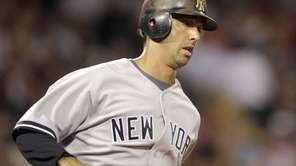 Jorge Posada rounds the bases after a hitting