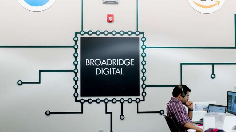 An employee at work at Broadridge Financial Solutions'