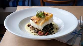 Nut-crusted Atlantic halibut is served atop petit French