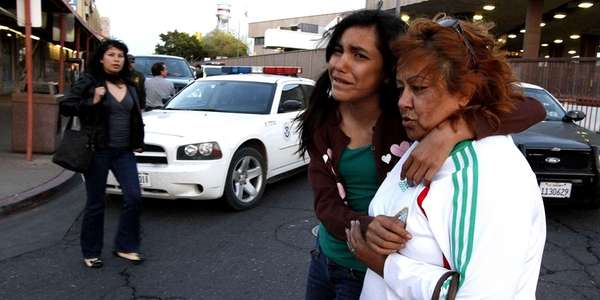 People walk through downtown Calexico, Calif. after an