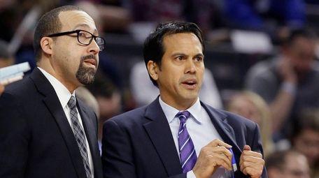 Heat head coach Erik Spoelstra, right, talks with