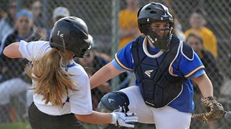 Julianna Budriss, West Islip catcher, right, tries to