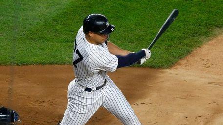 Yankees' Giancarlo Stanton follows through on a third-inning