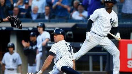 Yankees outfielder Brett Gardner scores a run in
