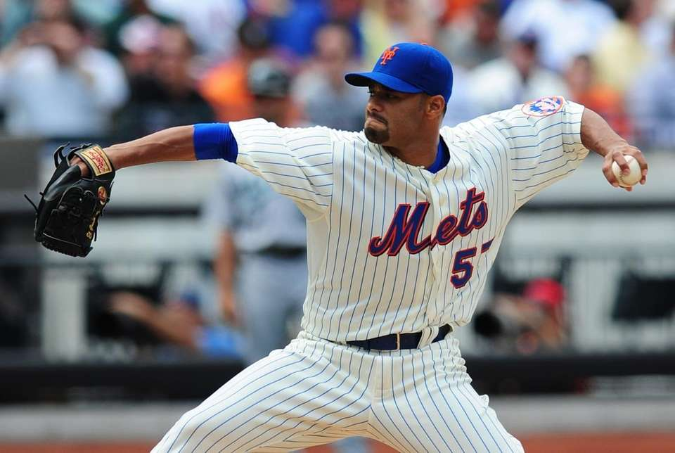 New York Mets pitcher Johan Santana throws early